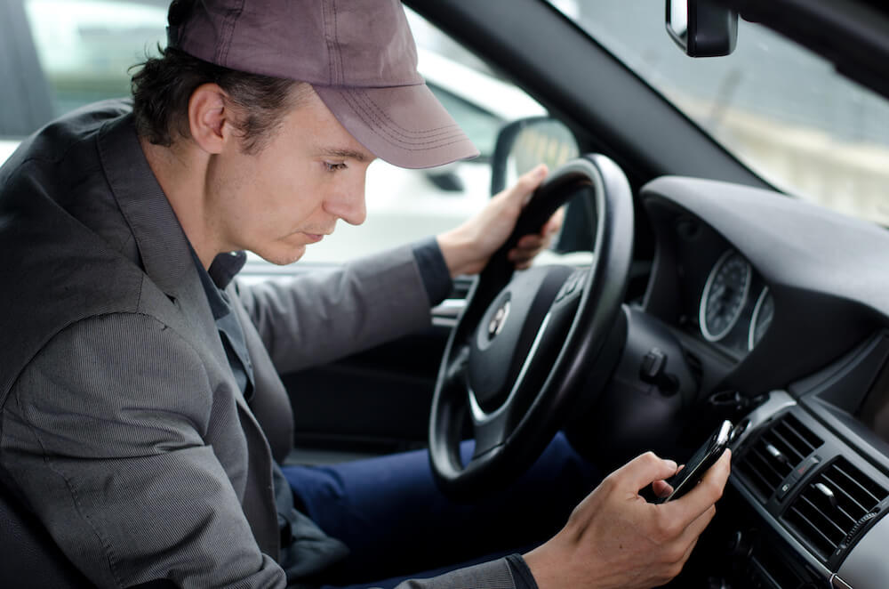 Texting and driving is highly dangerous and can really hurt your truck insurance rates.