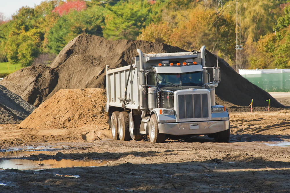 There are a few ways to save money on your dump truck insurance coverage.